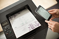 Mobile phone with laser printer